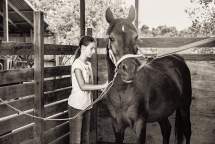 Hannah and her favorite horse Blackie