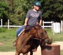 Emily learning barrel racing on Ginger